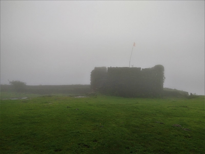 Foggy conditions at Visapur Fort trek top