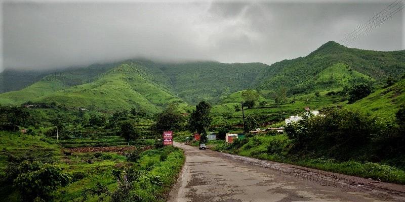 Lush green valley en route to Purandar Fort