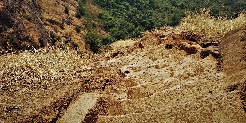 Rock cut stairs as seen on Kalavantin Durg Trek