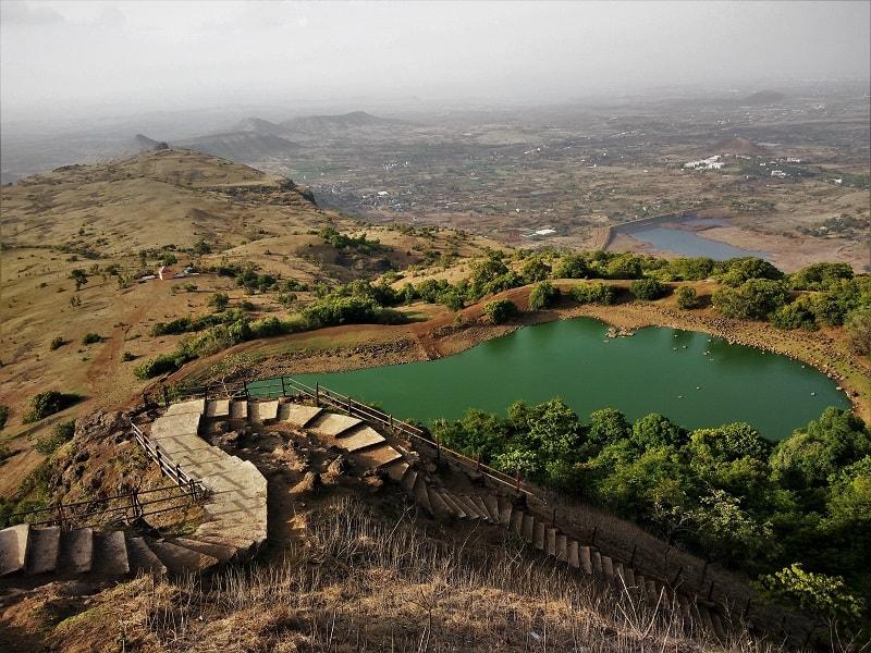 Small green water lake on Anjaneri Fort trek