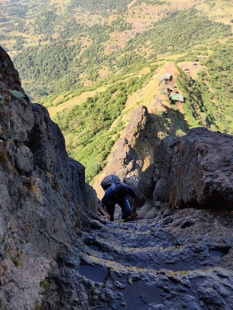 climbing at the Harihar fort steps Nashik