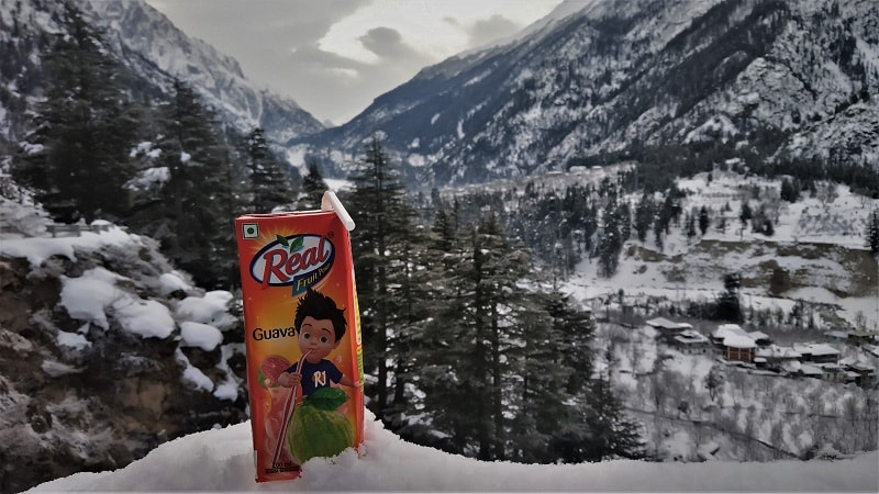 drinking real juice on way to Chitkul in winters