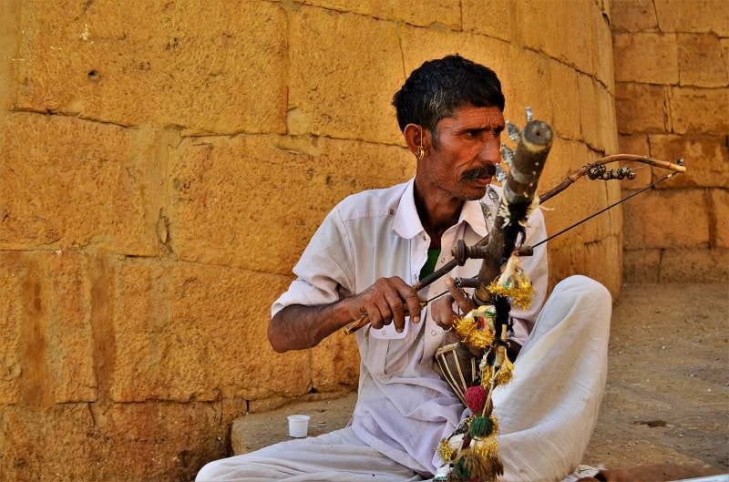 local playing some instrument at jaisalmer