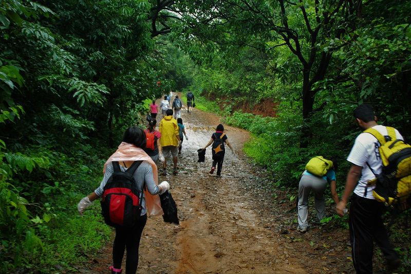 trekkers cleaning the way Rajmachi Fort Trek